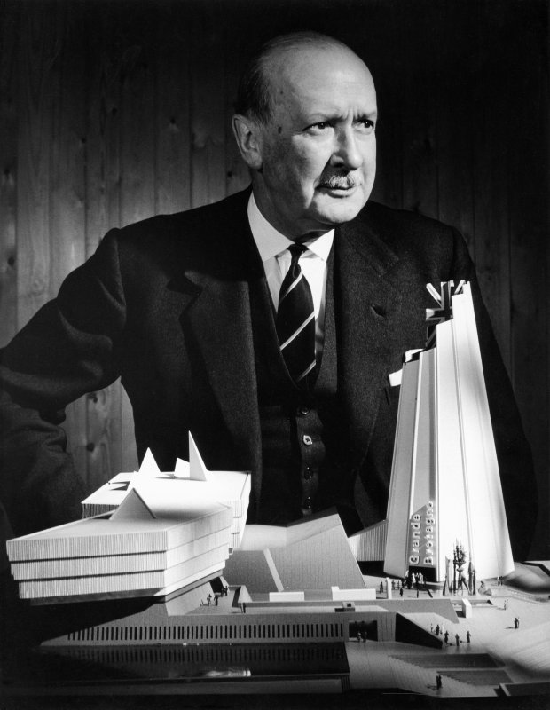 View of Sir William Oliver with the model of the British Pavilion for Expo 67.