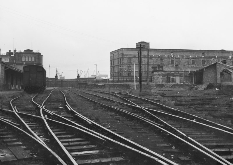 Scanned image of photograph showing view from SW looking to terminal buildings with Bonded Warehouse on Commercial Street in background.