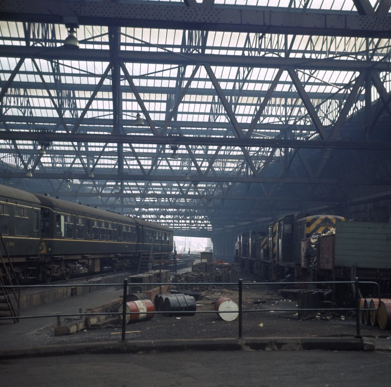 Interior.  View within train shed from W showing diesel units and shunters.