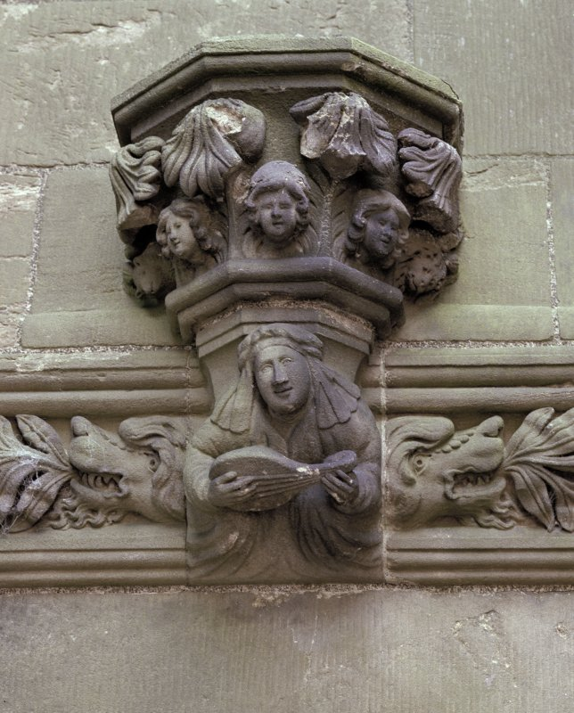 East range, great hall, fireplace, detail of corbel.