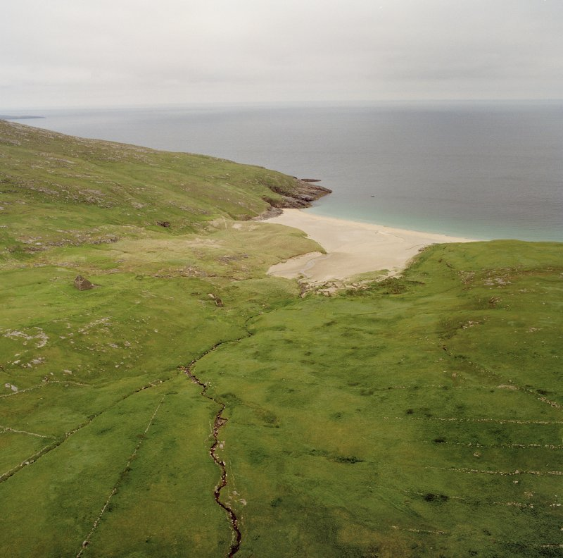 Mingulay, oblique aerial view centred on the remains of the township with the remains of the chapel house adjacent, taken from the SW.