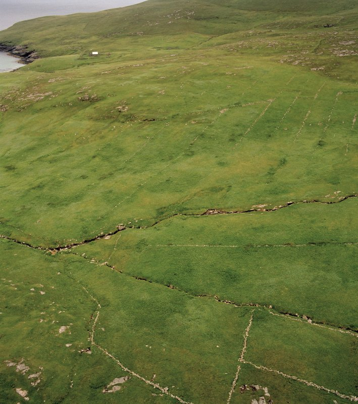 Mingulay, oblique aerial view of the remains of the crofting strips, head-dykes and field enclosures, taken from the N.