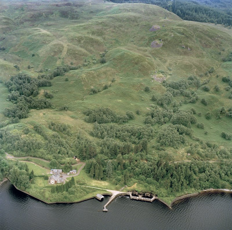 Oblique aerial photograph of Loch Katrine, Royal Cottage (NN40NW.25), Aqueduct Intakes (NN40NW.26),  Pier and Boathouse (NN40NW.24), also showing path of Loch Katrine Tunnel