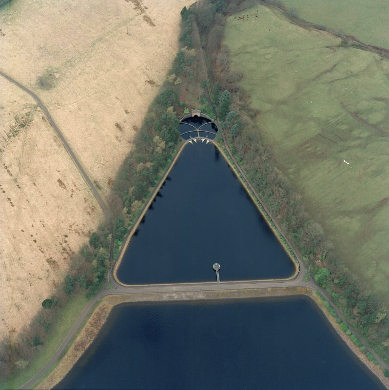 Scanned oblique aerial view of the gauge basin and measuring pond of Craigmaddie (NS57NE 61) Reservoir