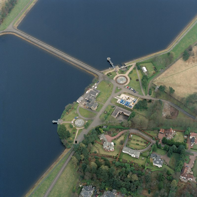 Scanned oblique aerial view of the junction between Mugdock (NS57NE.63) and Craigmaddie (NS57NE.61) Reservoirs including Mugdock Straining Well (NS57NE 63.05) and Chlorinating House (NS57NE 63.04)