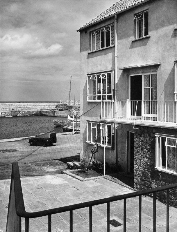 View of three-storey courtyard block looking towards harbour.