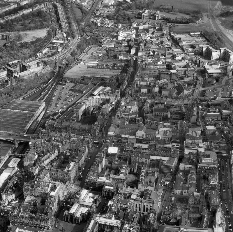Oblique aerial view of centre of Edinburgh including Holyrood Palace at top of photograph, Chamber Street at right, St Giles' Cathedral at bottom and Waverley Station and St Andrew's House at left