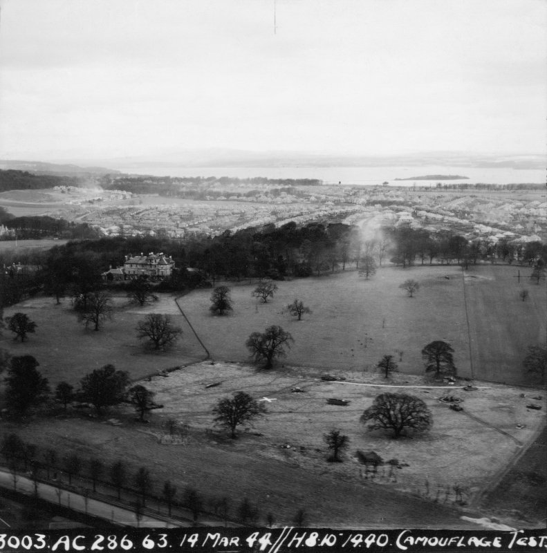 Wartime papers. Oblique aerial view from SE showing camouflage test.