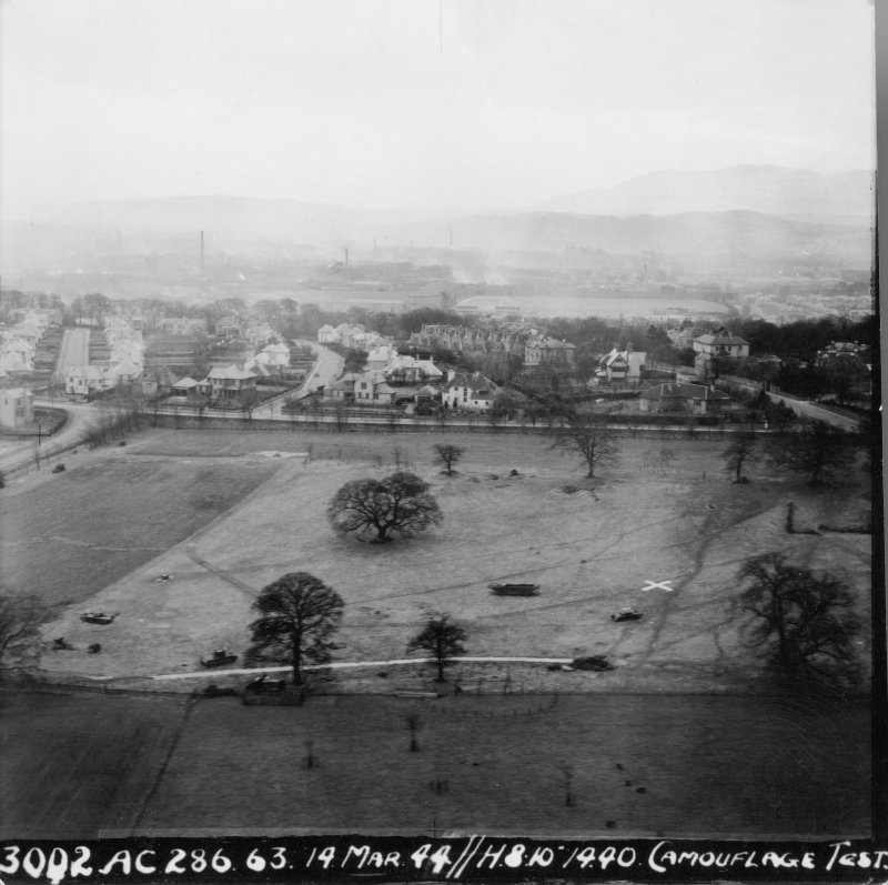 Wartime papers. Oblique aerial view from N showing camouflage test.