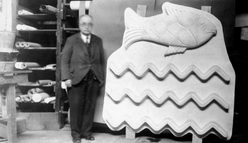Empire Exhibition, ICI pavilion. Photographic view of sculptor Thomas Whalen next to relief sculpture for pylon.