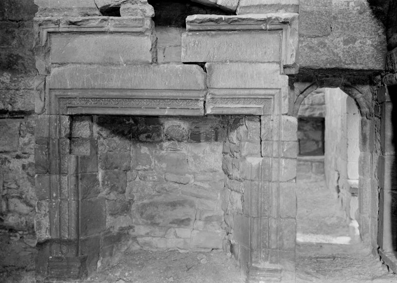 Interior. View of fireplace in room on second floor wing.