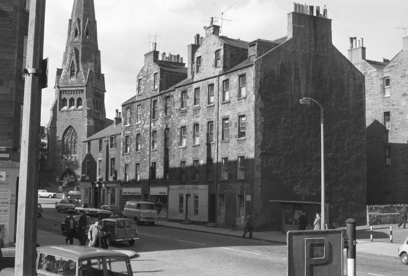 Oblique view of the front facades of No. 1 - 15 Buccleuch Street seen from the South South West with the Buccleuch and Greyfriars Free Church in the background.