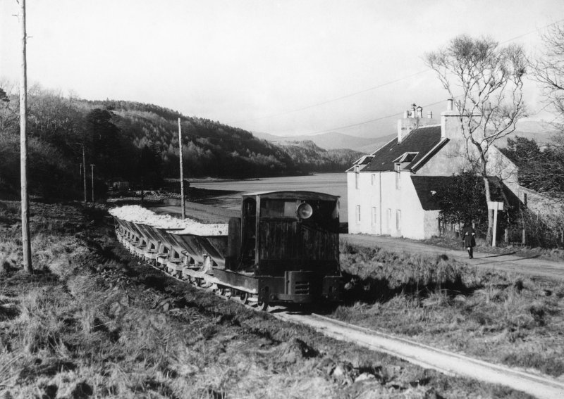 Scanned copy of view of train bringing sand along the shore of Lochaline from the mine to the processing plant at the West Pier (NM64SE 38.01)