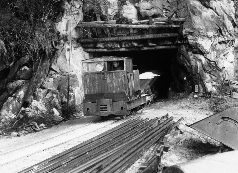 Scanned copy of view of locomotive and train of waggons leaving the mine for the processing plant.