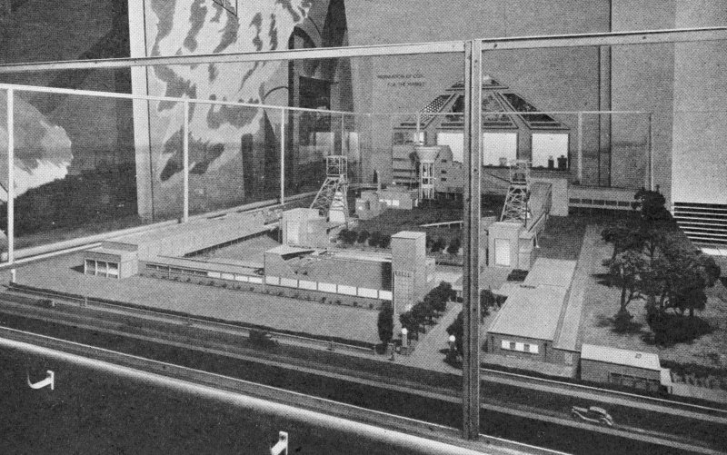 Scanned copy of image from annual report of Miners' Welfare Fund, 1938, Figure 8, Empire Exhibition, Glasgow, 1938, Model Coal Mine with baths front centre, exhibited by the Mining Association of Great Britain