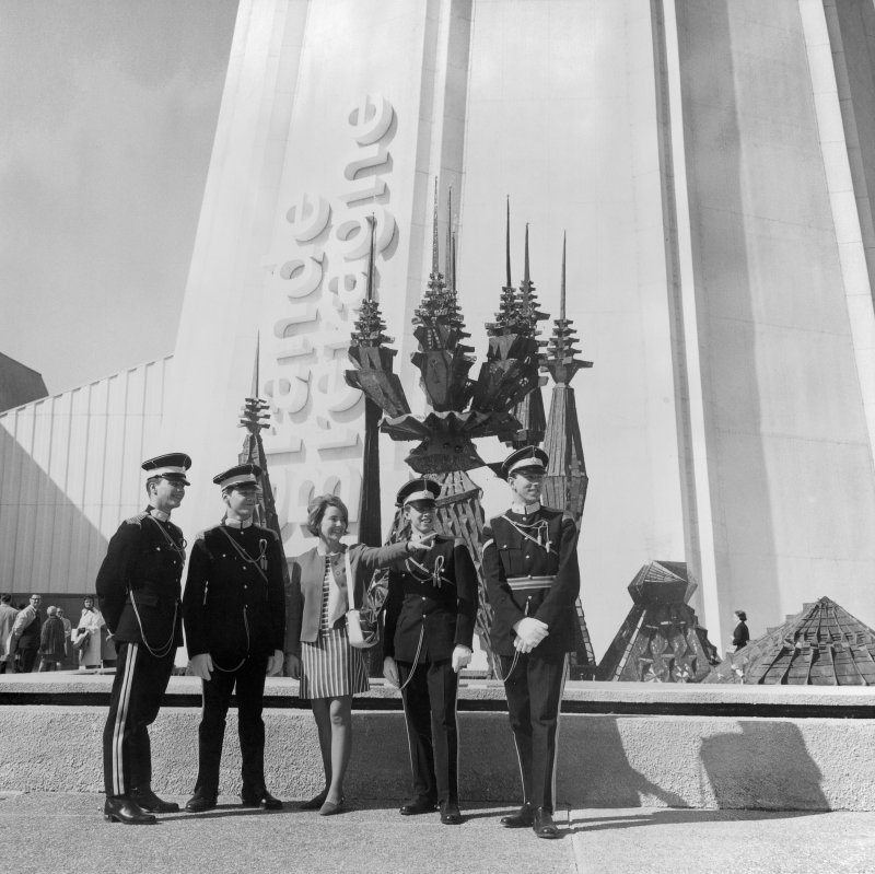 General view of the British Pavilion at Expo 67 showing British soldiers talking to one of the British hostesses.