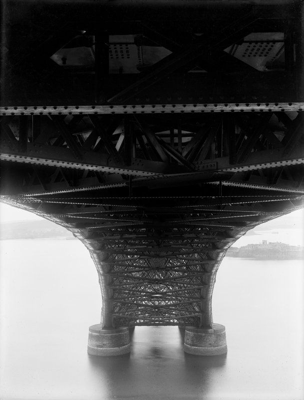 View from the underside of the Forth Bridge looking towards one of the piers with the structure visible in detail.