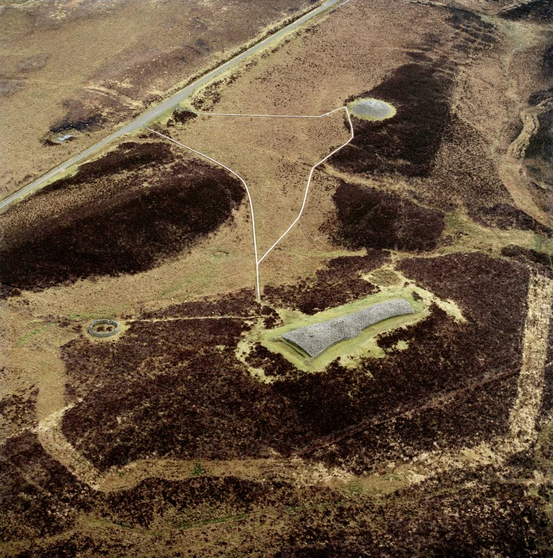 Oblique aerial view centred on the remains of Camster chambered  cairns, taken from the NW.