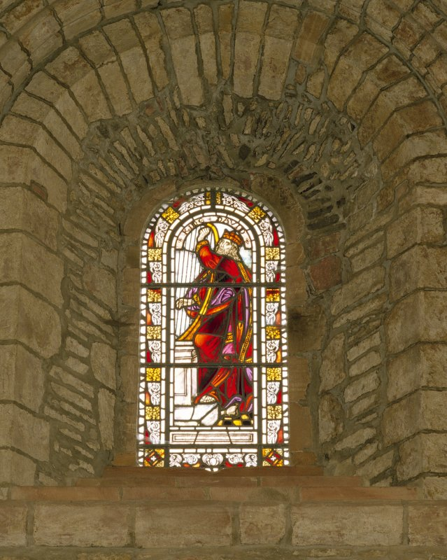 Interior.  Nave, S aisle, 3rd bay from W, detail of stained glass window (King David).