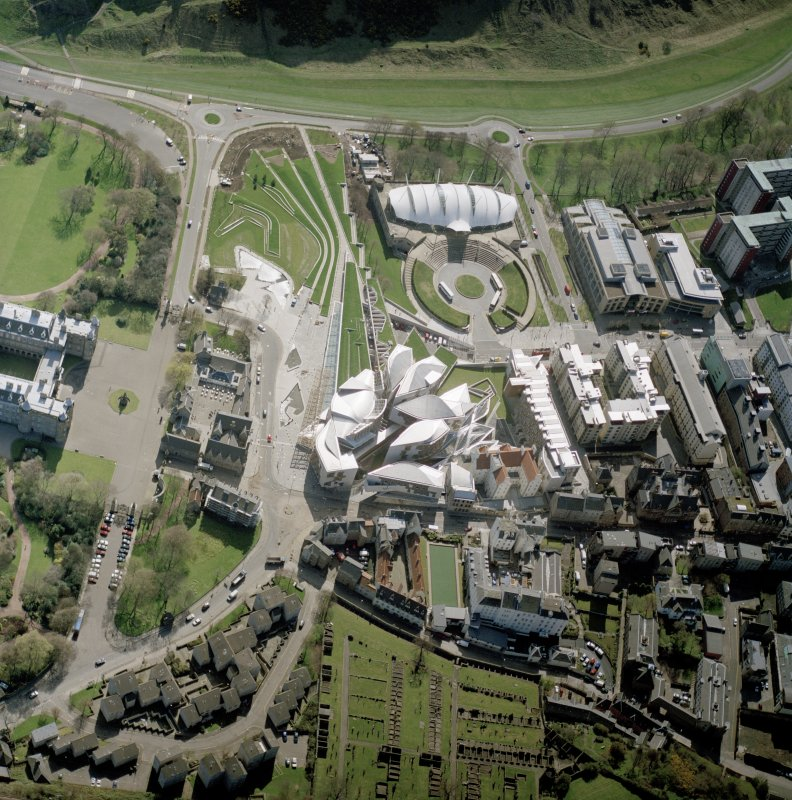 Digital copy of a photograph of oblique aerial view centred on the Scottish Parliament building with the exhibition centre adjacent, taken fro the NNW.