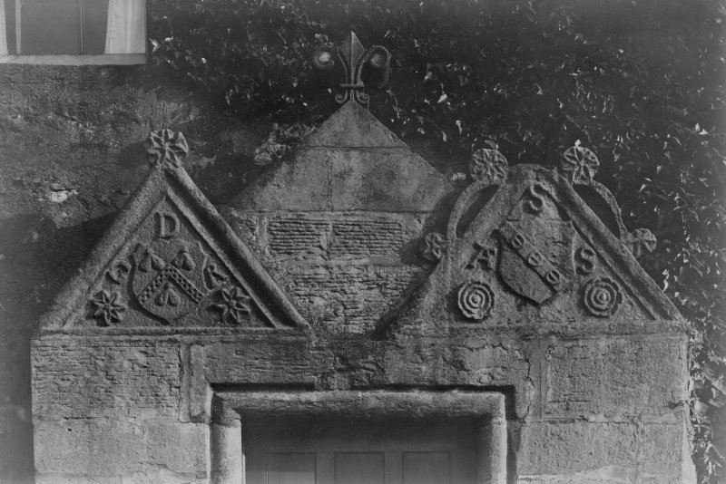 Historic photograph. Detail of pediments over doorway.