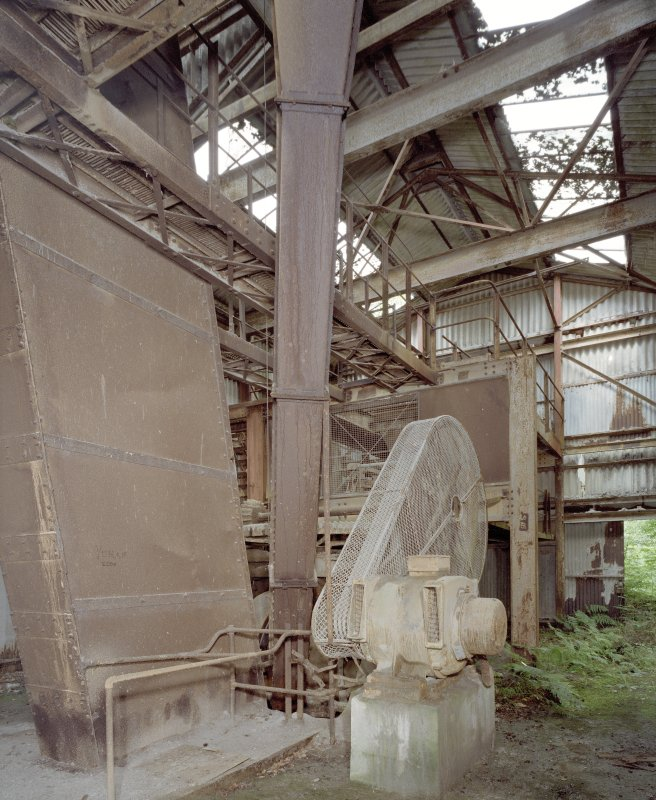 Interior. View in 1950's pan mill, bucket elevator on right.