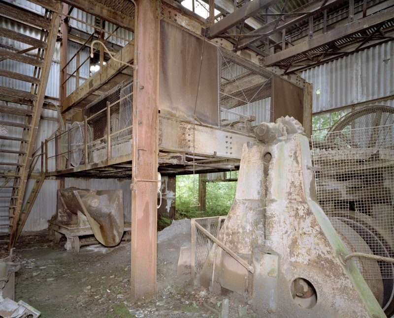 Interior. Pan House from 1950s. View of pan mill on right, worm feeder in background.