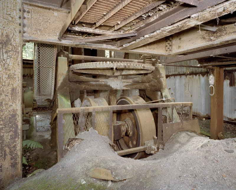 Interior. Pan House from 1950s. View of pan mill. Clay visible in the foreground.