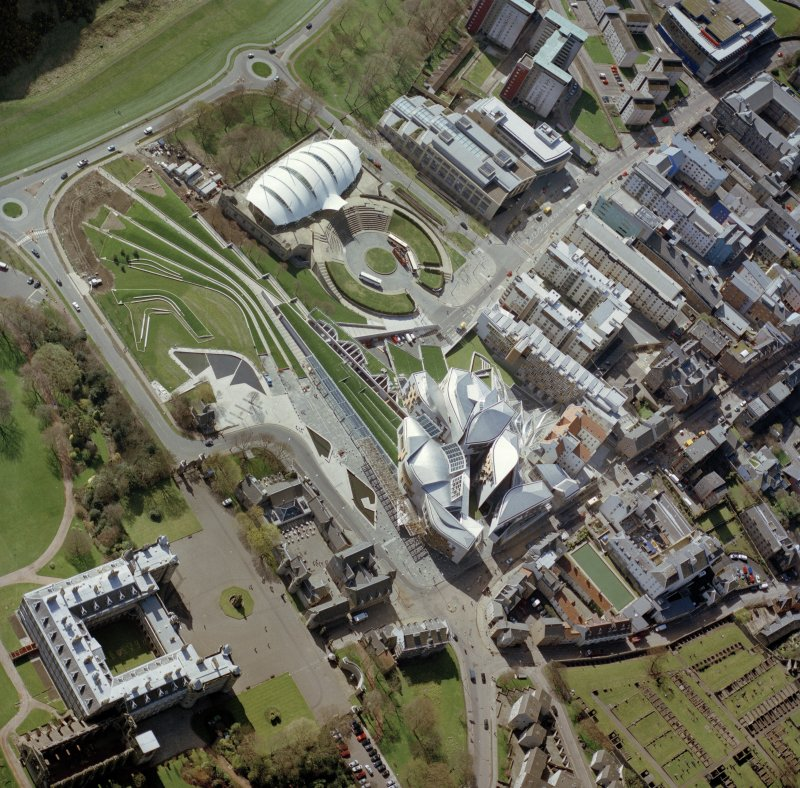 Oblique aerial view centred on the Scottish Parliament building with the exhibition centre and palace adjacent, taken from the NNE.
