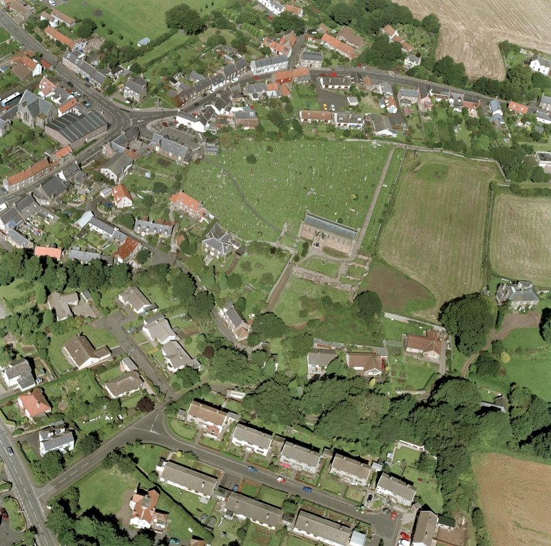 Oblique aerial view of Coldingham centred on the church, taken from the SSE.