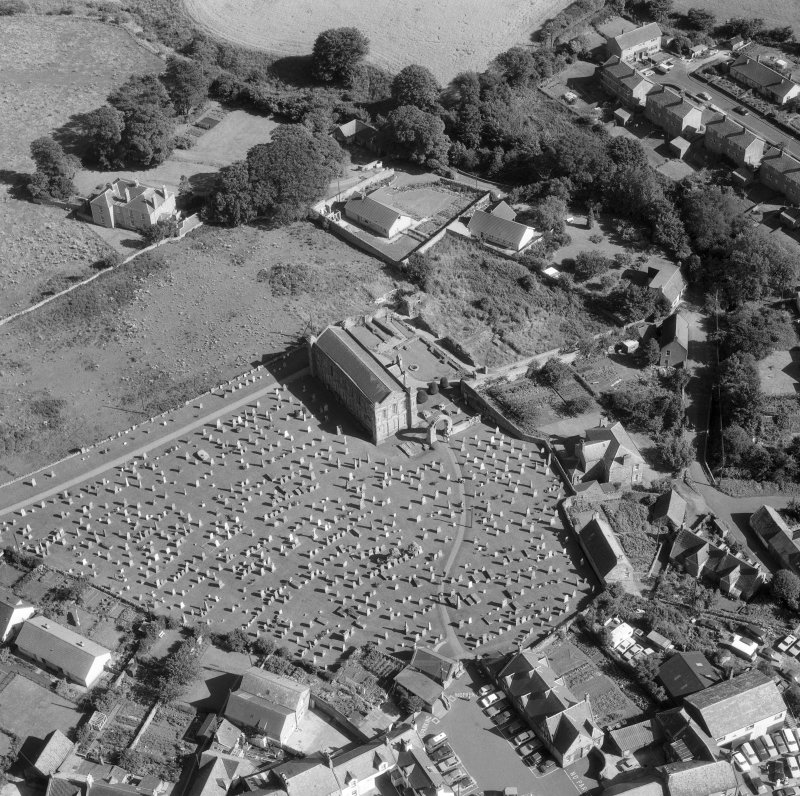 Oblique aerial view centred on Coldingham Church.