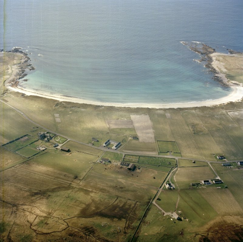 General oblique aerial view looking towards the bay of Culla across the farmhouse, the farmstead, the farmsteading and the burial enclosures adjacent, taken from the ESE