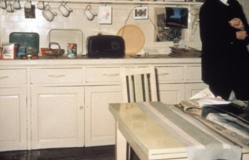 Glasgow, 1 Princes Terrace, interior Detail of kitchen showing tilled wall and built in cupboards.