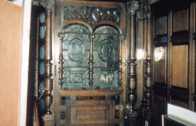 Glasgow, 1 Princes Terrace, interior Detail of glazed and carved oak main door in hall.