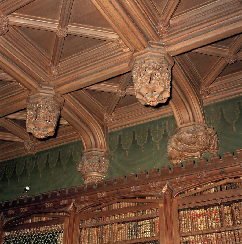 Library, interior, detail of carved wooden ceiling bosses.