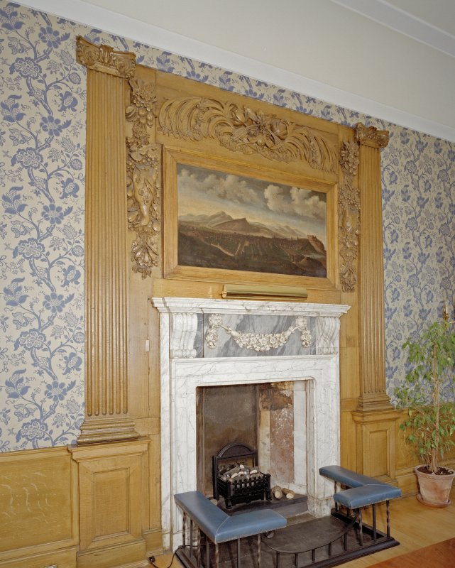 Interior. Detail of white marble fireplace if Blue Room showing carved wooden surround.