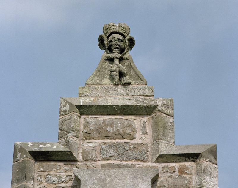 North east gateway, detail of carved figure on wall above.