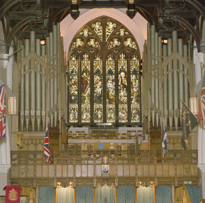 Interior, detail of stained glass window and organ at W end.