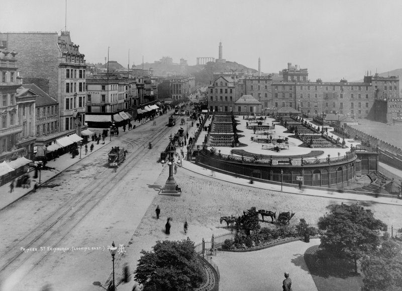 View from Scott Monument, Edinburgh, looking east towards Calton Hill showing the buildings before making way for the North British Hotel, Waverley Gardens and a busy Princes Street with shop awnings, pedestrians, trams and horse and carriages.   Print inscr; 'PRINCES ST. EDINBURGH. (LOOKING EAST.) 26 AI'