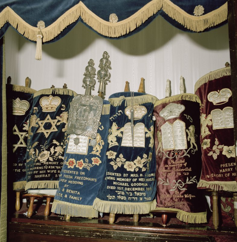 Digital copy of photograph of interior. Ark. Detail of Torah scrolls