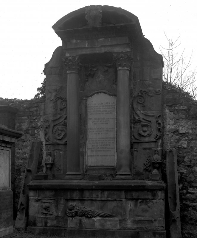 General view of Carstairs monument in wall of churchyard.