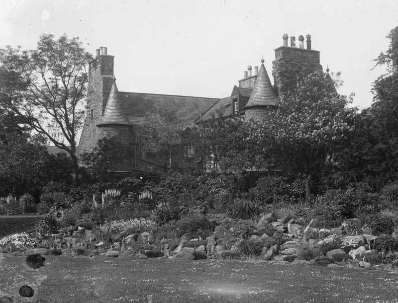 General view of Croft an Righ House from South, showing part of garden