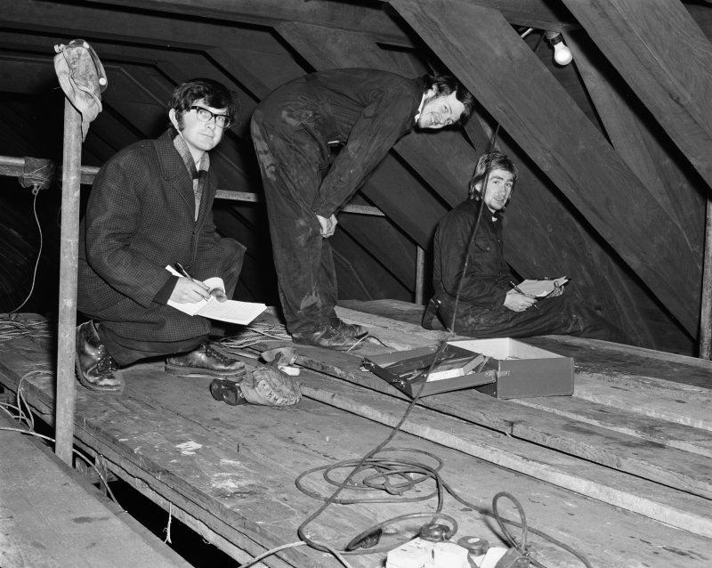 Geoffrey Stell, Duncan Peat and Alan Leith surveying in the roof of Glasgow Cathedral