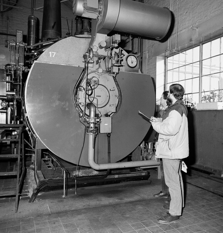 Miles Oglethorpe and Graham Douglas inspecting boiler at railway enginnering works at Springburn, Glasgow (St Rollox)