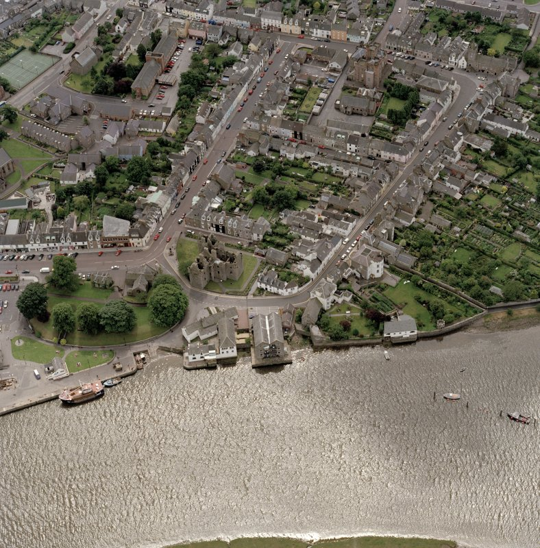 Oblique aerial view of Kirkcudbright centred on MacLellan's Tower, taken from the N.