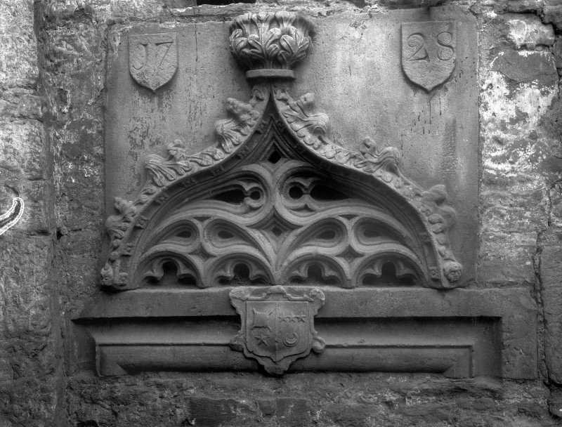 View of sculptured details dated 1728 of a niche head inserted in the back of a garden seat at Grange Loan Garage (formerly Bloomsbury Laundry).