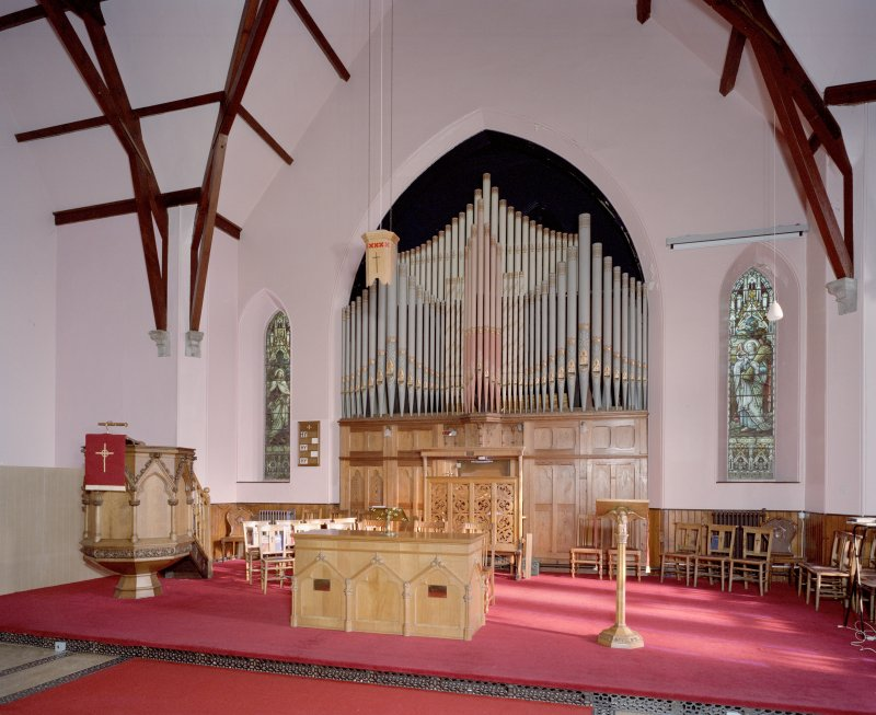 Interior. Platform. View from WSW showing organ, pupit, communion table and lecturn