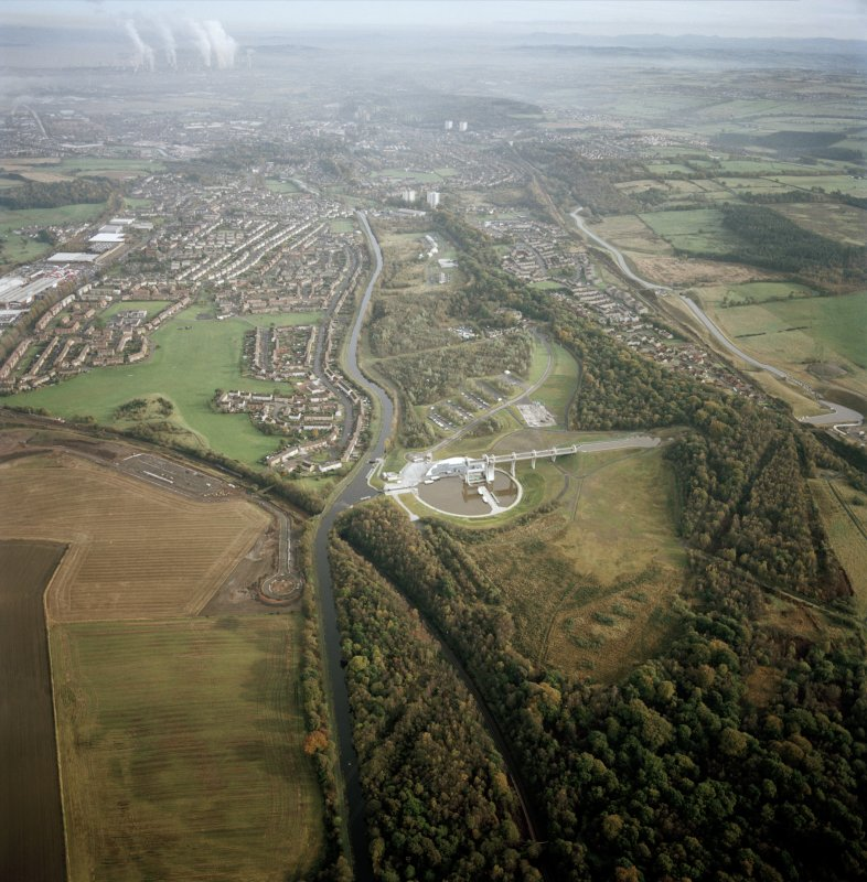 Digital copy of photograph of general oblique aerial view looking across the Falkirk Wheel and canals towards Falkirk and Grangemouth, taken from the WNW.