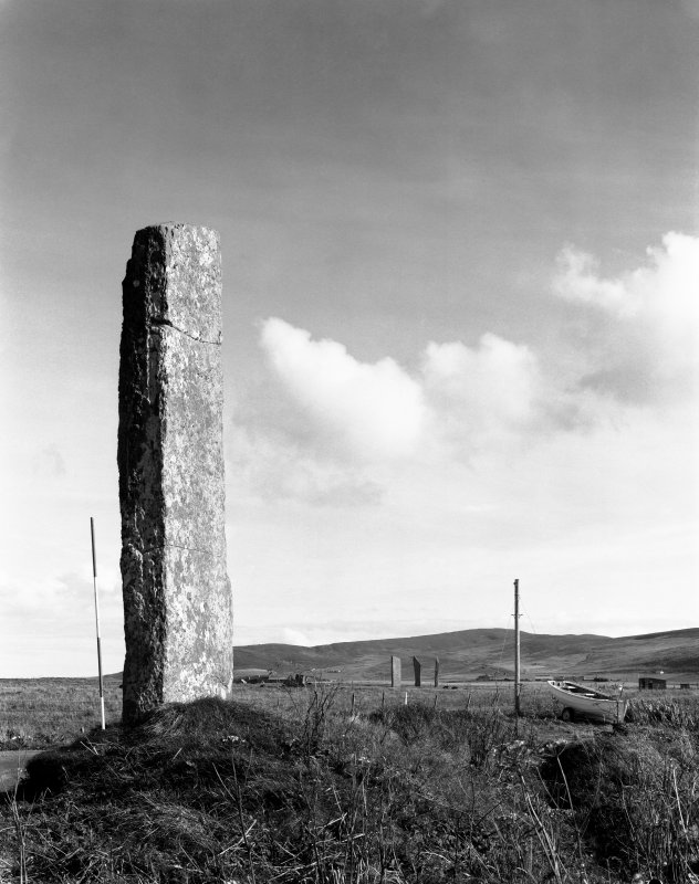 Digital copy of watchstone with Stones of Stenness in background, from N.W.