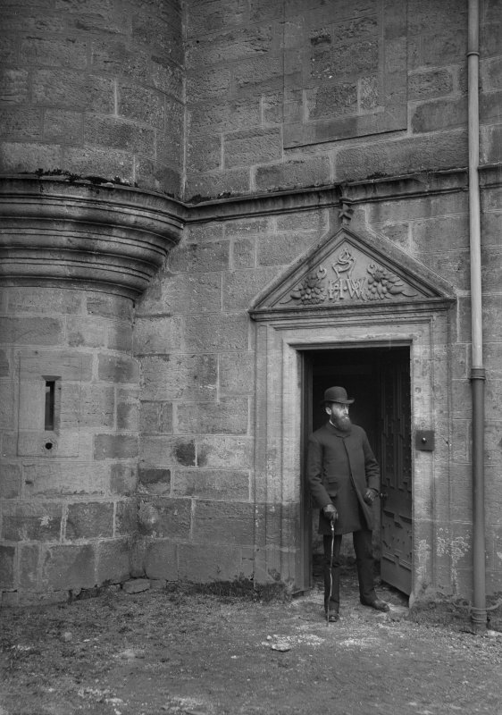 View of man in doorway of Pitreavie Castle. Annotation on print: 'William Beveridge?'.